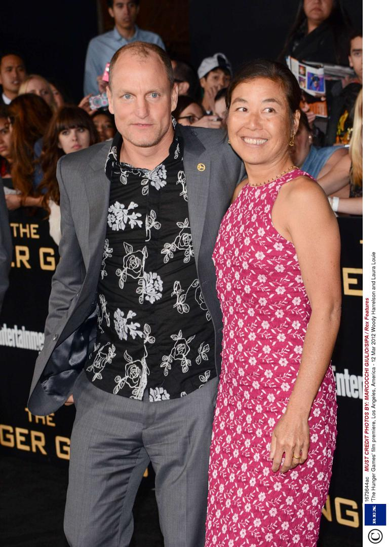 Woody Harrelson and his longtime love Laura Louie, who were officially married in December 2008 on the island of Maui