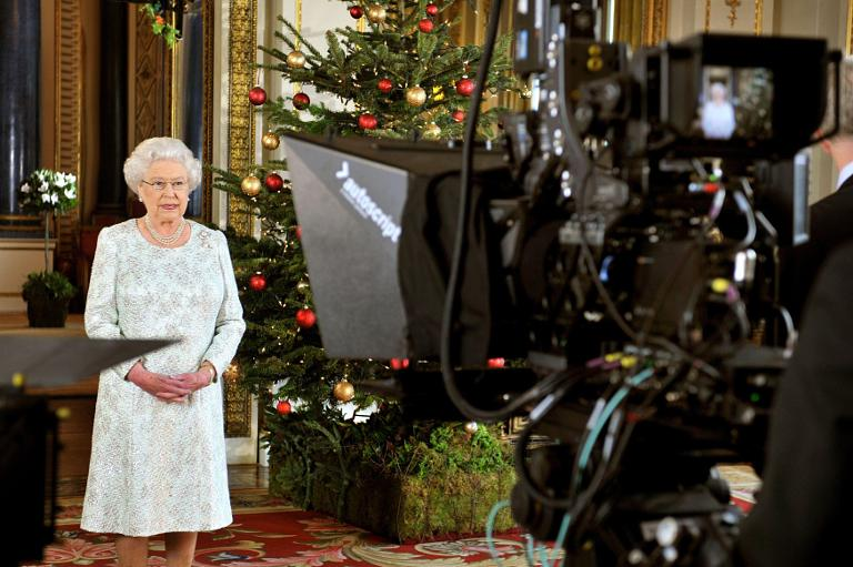 Queen wears crystal-studded 3D glasses to review TV message - pictures