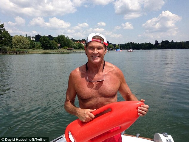 003163168c Hasselhoff is seen wearing his famous red shorts and playing around with a  lifesaver in the photos. He played lifeguard Mitch Buchannon in Baywatch ...