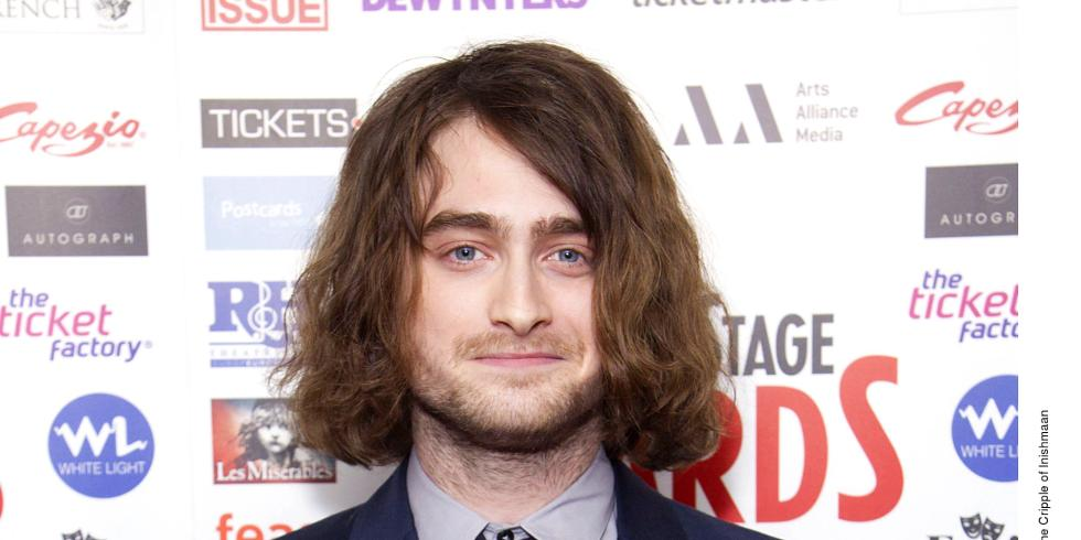 Daniel radcliffe collects theatre award in long hair extensions pmusecretfo Choice Image