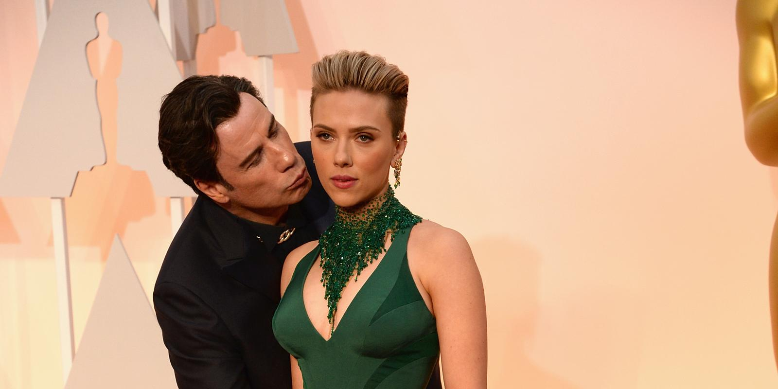 John Travolta Creeps Up On Scarlett Johansson For Awkward Surprise Kiss