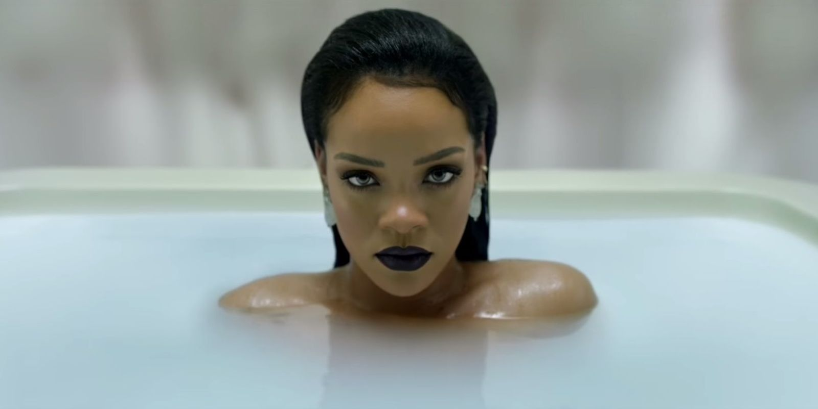 rihanna sits in the bath as we all still wait for her to