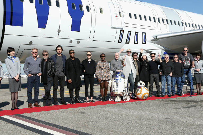 The Star Wars: The Force Awakens cast travel on a R2-D2 themed plane