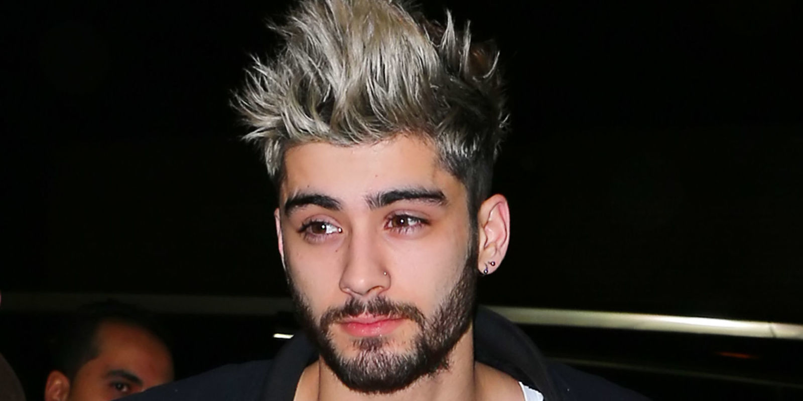zayn malik isn t on friend terms with louis tomlinson but says his