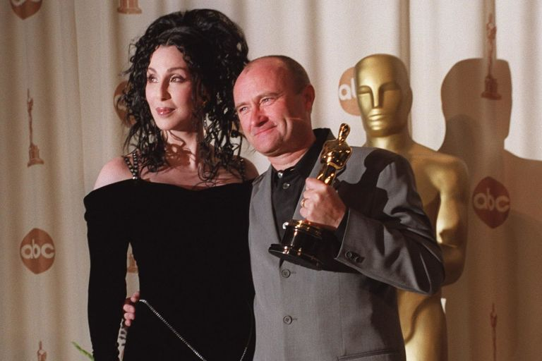 Phil Collins and Cher backstage at the 72nd Academy Awards