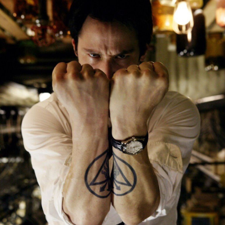 12 baddest ass tattoos in movies from george clooneys neck to tom keanu reeves in constantine maxwellsz