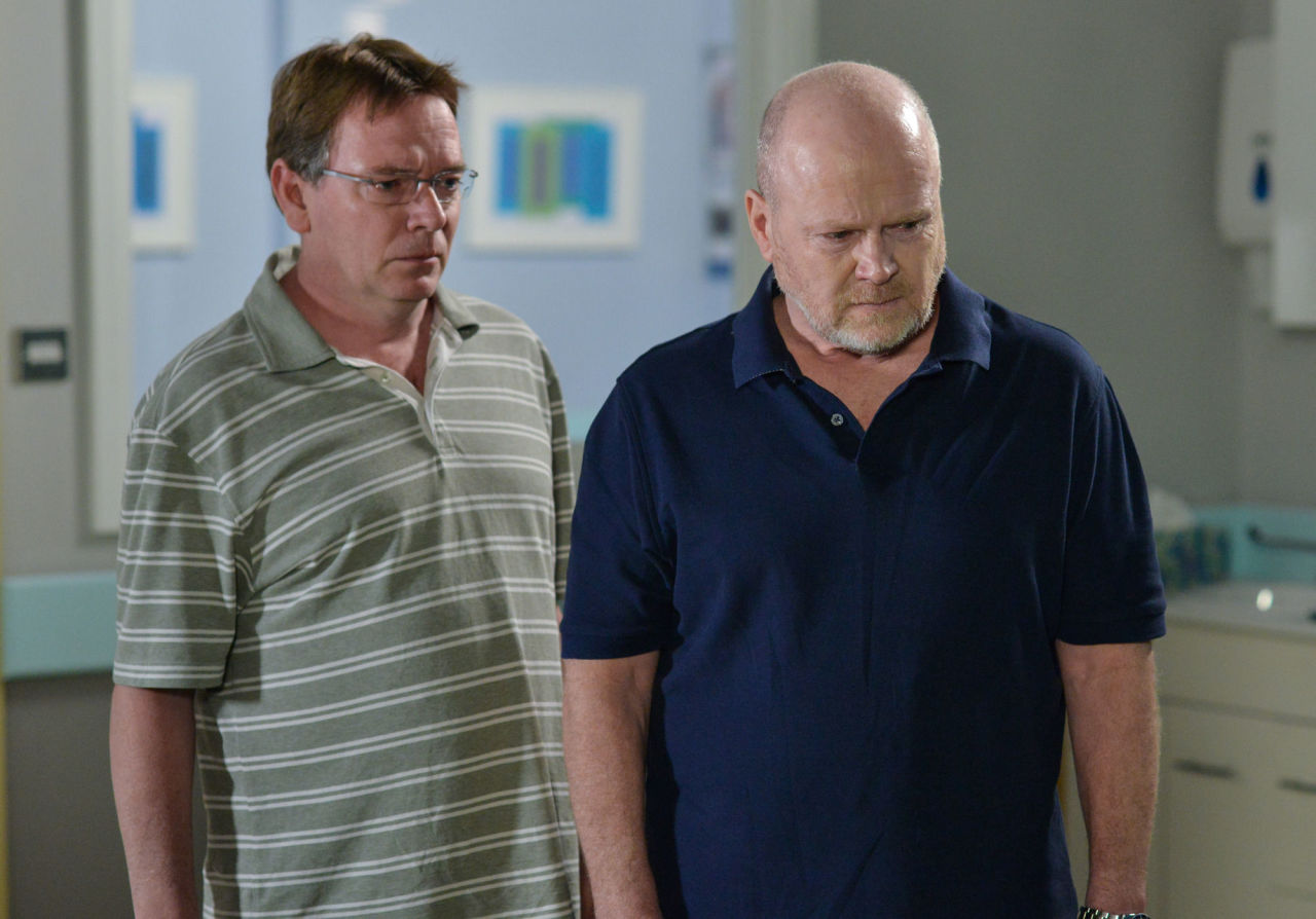 Ian Beale and Phil Mitchell are taken in to view Ben's body in EastEnders