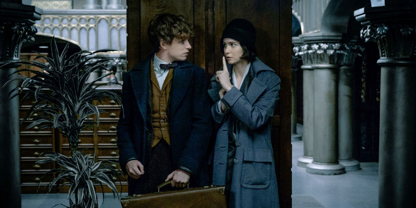 Why the hell is the deathly hallows symbol in colin farrells exclusive eddie redmayne as newt scamander katherine waterston as porpentina goldstein in fantastic beasts and biocorpaavc Gallery
