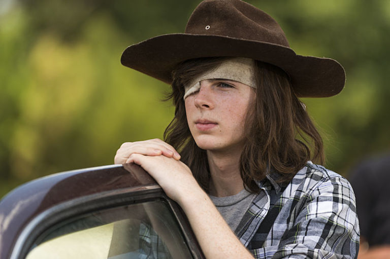 Chandler Riggs as Carl Grimes in The Walking Dead Series