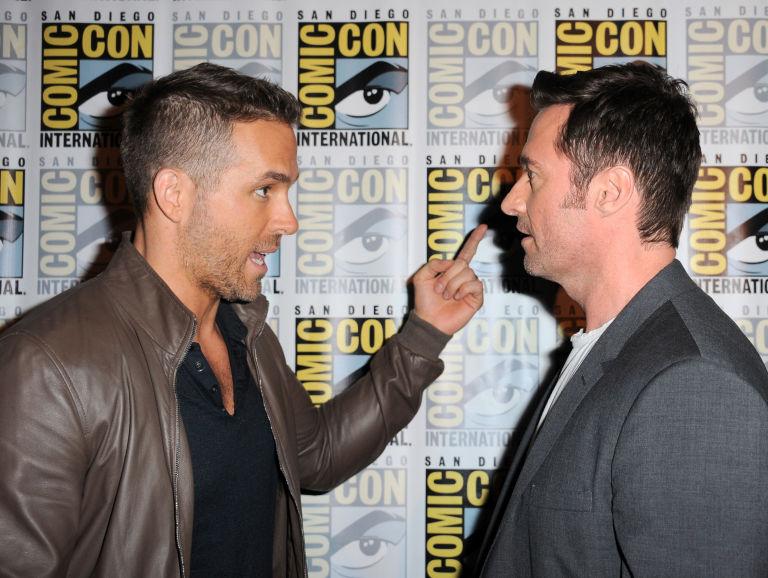 Ryan Reynolds (L) and Hugh Jackman attend the 20th Century FOX panel during Comic-Con International 2015