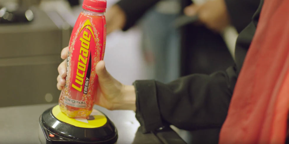 Lucozade provide commuters with free trip on underground with contactless bottles