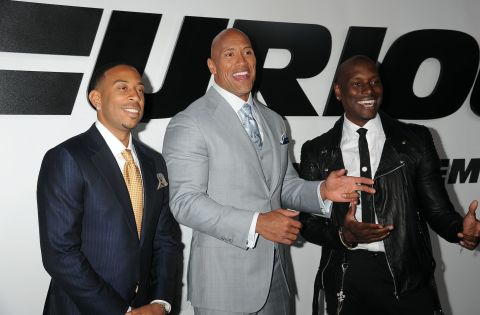 Chris 'Ludacris' Bridges, Dwayne Johnson and Tyrese Gibson arrive at the premiere of 'Furious 7
