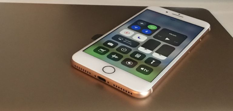 iphone 8 gold. apple iphone 8 plus control centre with macbook, gold iphone