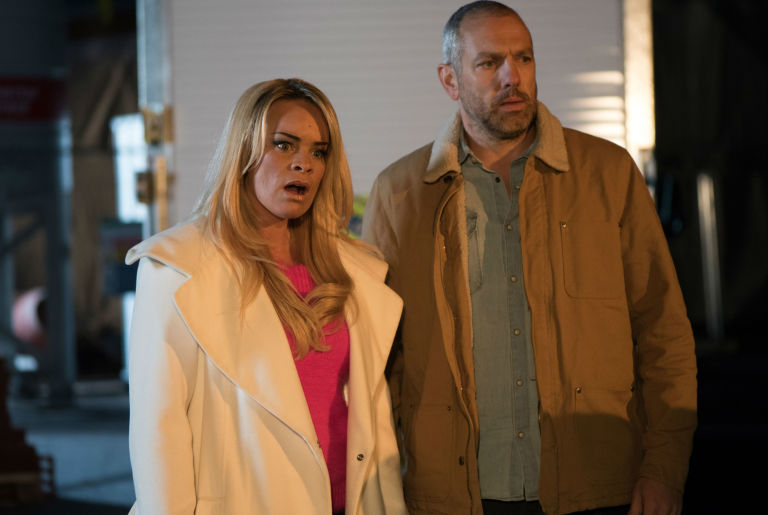 Grace Black and Glenn Donovan watch as Jesse gets arrested in Hollyoaks