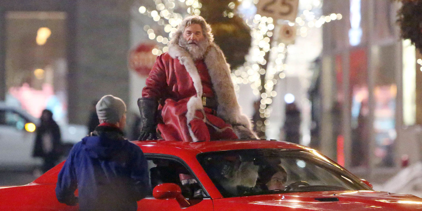 Kurt Russell rides a car dressed as Santa in first picture ...