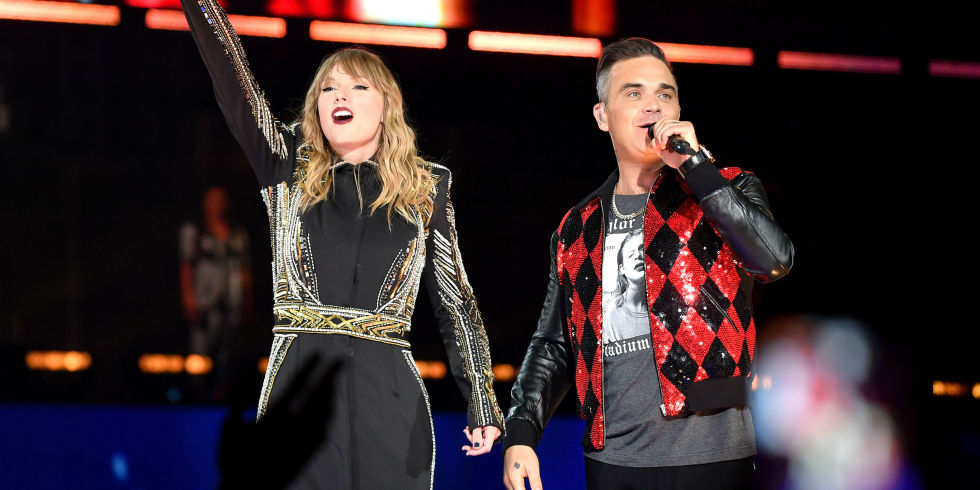 Taylor swift brings out robbie williams as surprise guest during taylor swift and robbie williams perform on stage at wembley stadium on june 23 2018 stopboris Gallery